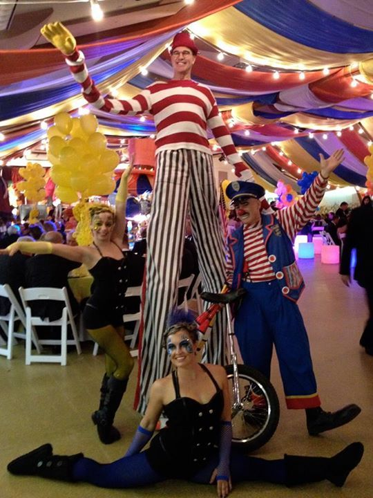 John Hadfield on stilts with the unicyclist and the contortionists
